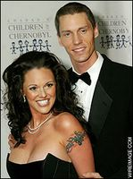 Anna Benson with husband Kris Benson showing cleavage